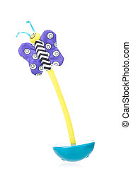Bright tumbler toy with butterfly isolated over white...