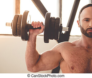 Man working out - Cropped image of handsome muscular man...