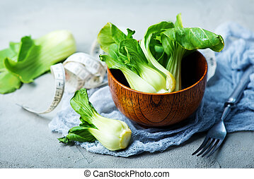 pak choy - fresh pak choy in bowl and on a table