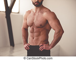 Handsome muscled man - Cropped image of handsome muscular...