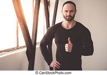 Handsome muscled man - Portrait of handsome muscular man in...