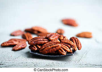 pecan - nuts on a table, dry pecan on the table