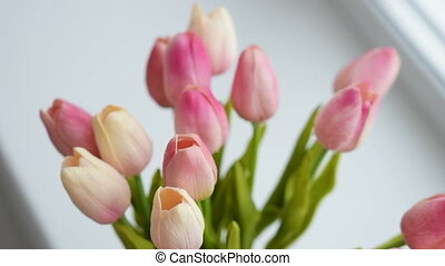 Close-up of a bouquet of tulips on a light background