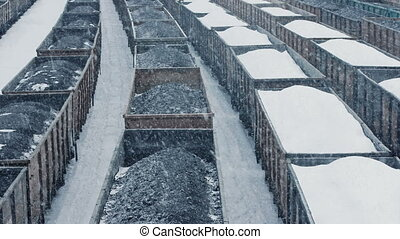 Train Yard With Coal Containers In Snowfall