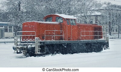 Train Engine In Heavy Snowfall - Red train engine in winter...