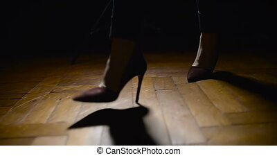 Woman Legs In High-Heeled Shoes Walking On Wooden Floor