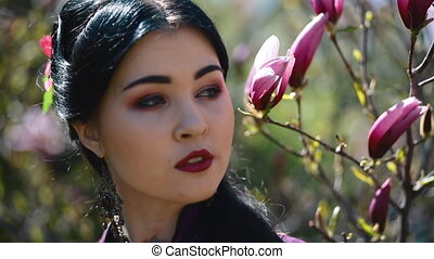 Young asian woman pose in blooming magnolia - Young asian...