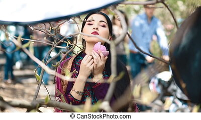 Asian young woman pose to photographer. Model stay near the...