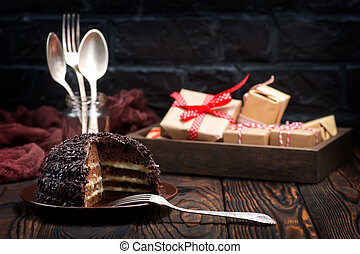 chocolate cake on plate and on a table