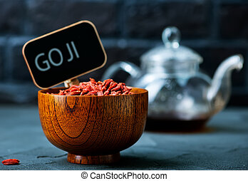 Goji - dry goji in bowl and on a table