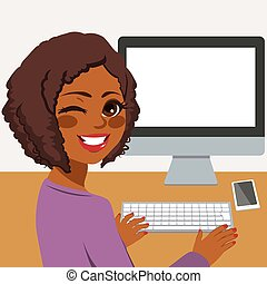 Woman Using Computer - Happy young African American woman...