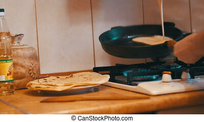Making of the Dough Pancakes, Flat Cakes on the Hot Frying Pan in the Home Kitchen