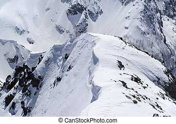 Snow cornice in high winter mountains in nice sun day....