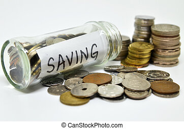 Saving lable in a glass jar with coins spilling out isolated...