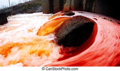 Bloody water flows into the river. Polluted water. - Bloody...