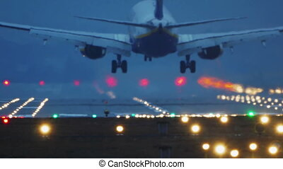 Commercial Airplane Landing at Night - Boeing 737-800...