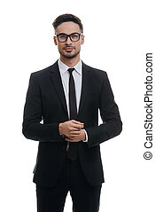Portrait of style. Handsome young man in full suit adjusting...