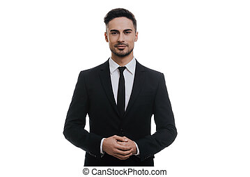Confidence and charisma. Handsome young man in full suit...