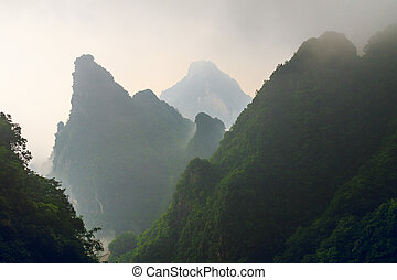 Huge Rock Mountain Silhouette with White Mist. Epic Mountain...