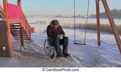 Disabled man on wheelchair crying
