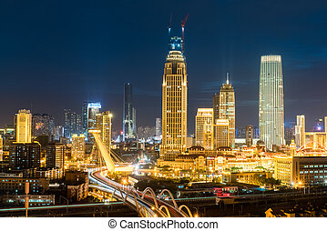 tianjin night scenes, modern buildings and road bridge in...