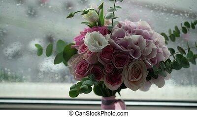 Bouquet with pink and white roses near window