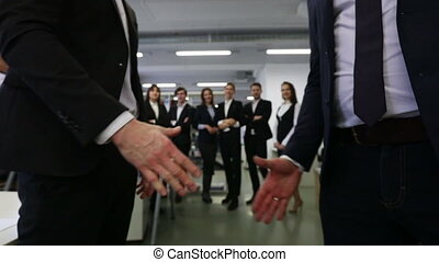 Handshake of business people, team of colleagues on...