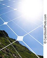 Solar energy concept - Mountain top with shining sun and...