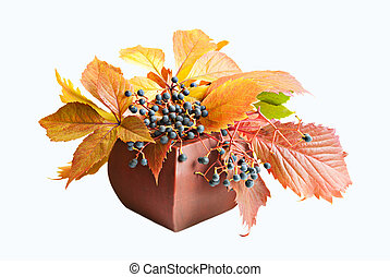 Autumn background - Wild Grape Leaves in vase