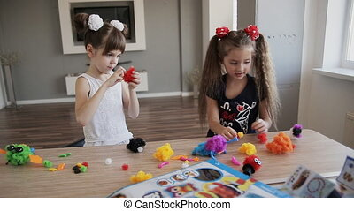 two girls play with toys