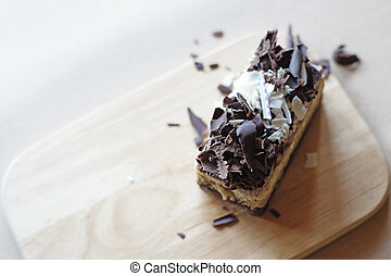delicious cake with chocolate slice on top