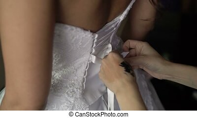 Wearing wedding dress closeup shot