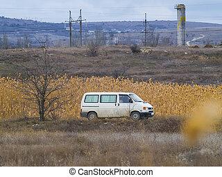White van rides somewhere down the road - The white van...