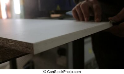 Worker produces pieces of furniture, close up