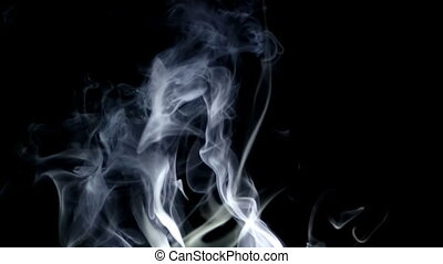 white smoke up on top in the dark