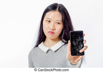 Asian schoolgirl with cracked cellphone