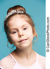 Cute little girl on a blue background close-up - Cute little...