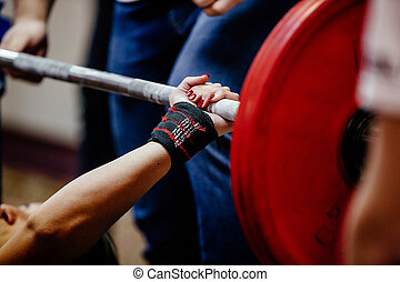hand wristbands young girl powerlifter bench press
