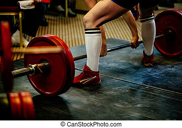 feet male athlete powerlifter deadlift competition...