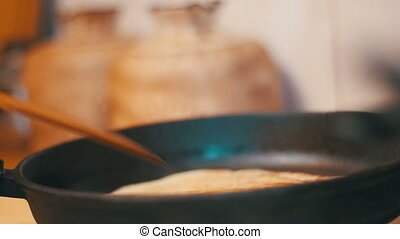 Cooking of the Dough Pancakes, Flat Cakes on the Hot Frying Pan in the Home Kitchen