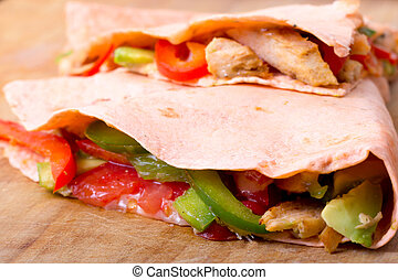 chicken loaded quesadilla closeup with bell pepper and...