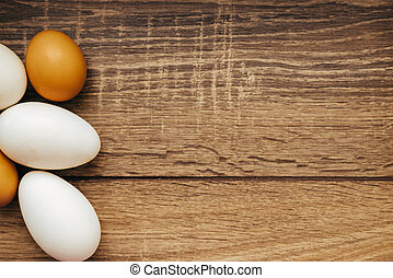 chicken eggs on wooden background - Close up of fresh...