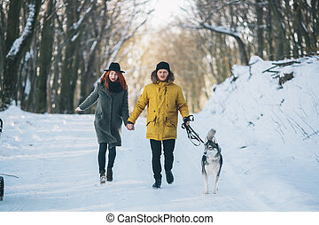 Couple with dog walking in the park
