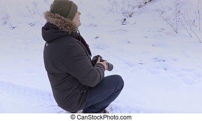 Man using professional photo camera