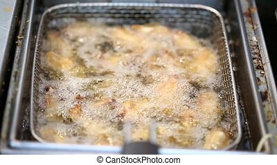 wings are fried in deep fat - chicken wings are fried until...