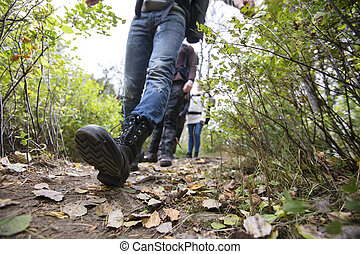 Man With Friends Walking On Hiking Trail