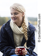 Beautiful Woman Holding Coffee Cup At Campsite