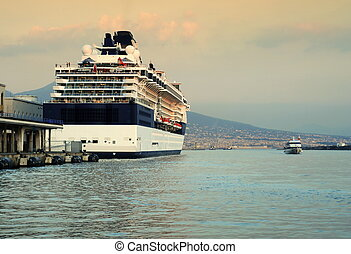 Cruise ship at Naples port during the sunset