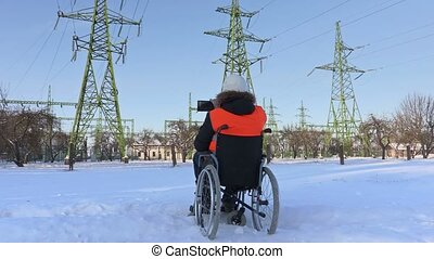 Disabled worker on wheelchair take pictures near to...