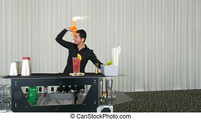 Bartender performing flair bartending with fireworks at a...